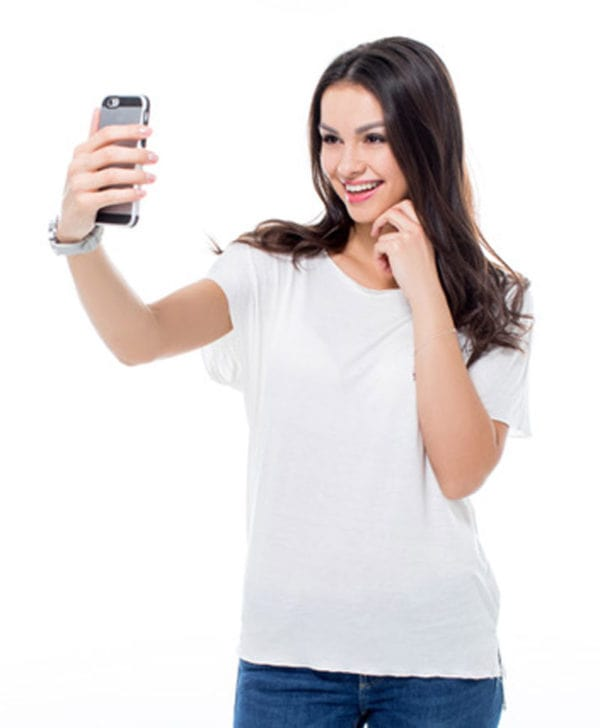 woman in white shirt taking a selfie
